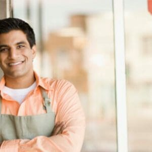 Worker welcoming new customers in store