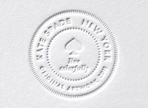 white kate spade debossed logo