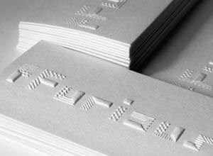 stack of white business cards with embossed logo