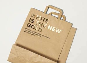 brown paper bag with gold foil writing