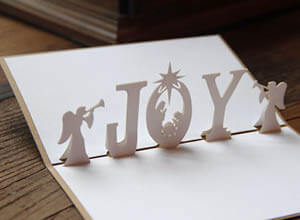 pop up white Christmas card made with laser cutting
