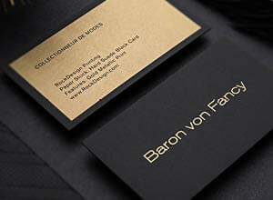 black business card with metallic gold ink