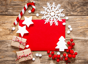 red christmas card on wooden table
