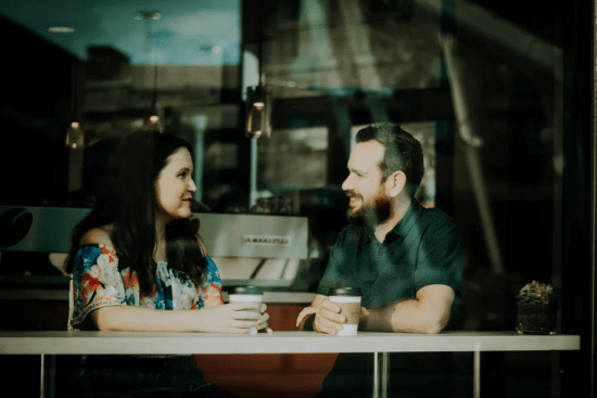 man and woman having coffee building workplace relationships