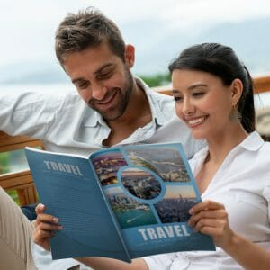 Couple looking at print marketing travel guide