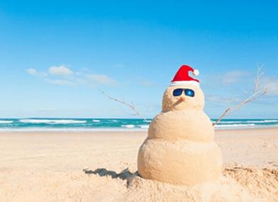 Christmas card with sand snowman