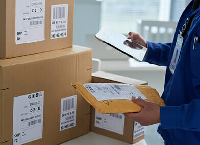 Mailing service staff barcoding packages