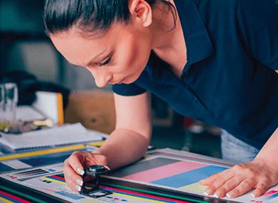 Kwik Kopy printer - staff reviewing offset printing job