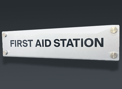 metal sign for first aid station
